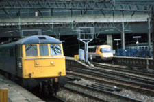 86 240 and APT-P wait departure from Euston on Monday 28 April 1985 © Colin Brooks